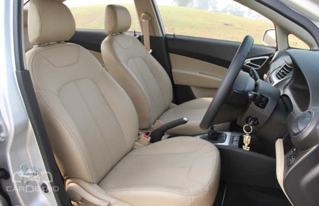 New leatherette upholstery looks good; comfortable seats hold the driver well in place