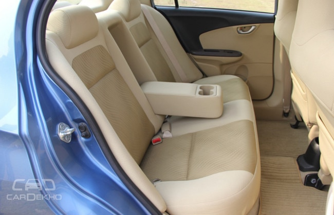 Honda's seats can hold three passengers; light colours makes the rear cabin feel airy; longer armrest more comfortable than the Sail